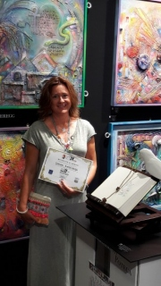 Diana Anderegg with her paintings, at art3f Palais des Féstivals Cannes